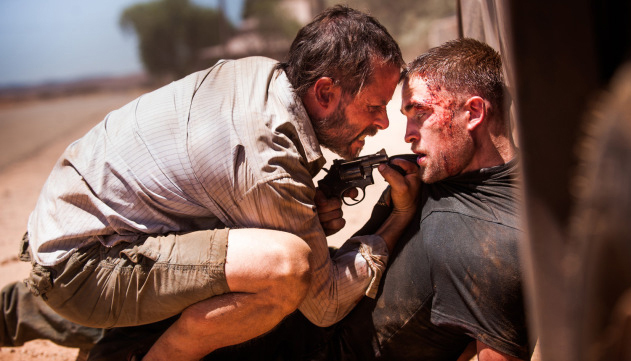 Guy Pearce and Robert Pattinson get physical in a scene from The Rover.