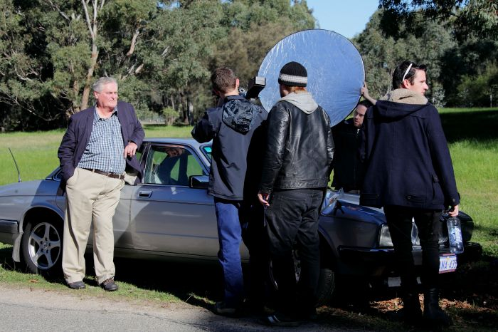Cast and crew on set with John Howard