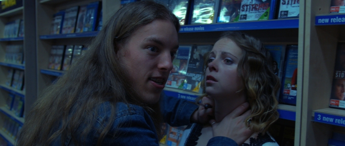 Noah Hess (Jesse-Michael Franciskovic) holds Lacey Sinclair (Alannah Robertson) at knife point.