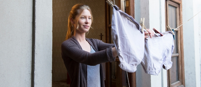 Carolyn (Emma Booth) considers her undies. Photo by Tungsten