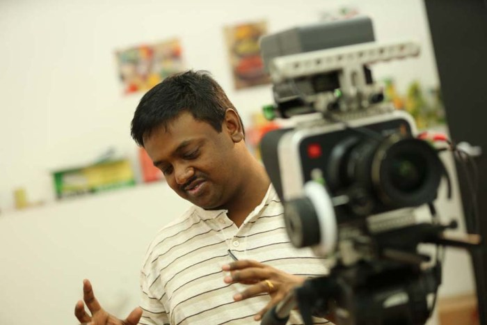 Director Julian Karikalan on the set of Love & Love Only.
